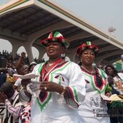 Women draped in the colors of the National Democratic Congress, the winning party of the 2012 presidential elections